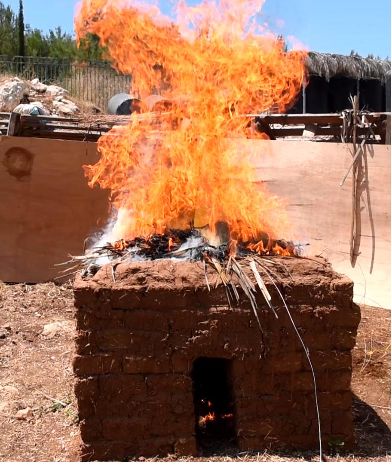 Experimental burning of a mud-brick structure (image courtesy of Igor Kreimerman)